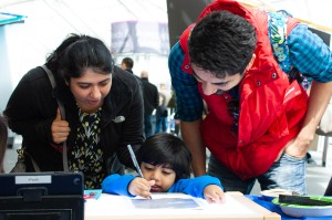 Visitors to the Adler Planetarium participate in a Zooniverse hands-on activity during Earthfest